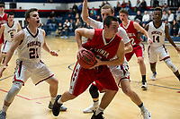 Laconia's Kelby Brooker charges Plymouth's Dan Carey during NHIAA Division III basketball Tuesday evening.  (Karen Bobotas/for the Laconia Daily Sun)