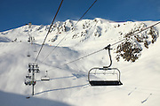 Chairlifts at the Peyragudes ski resort, Midi-Pyrenees, France.