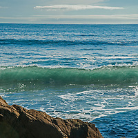 A transluscent wave breaks near rocks at Bean Hollow State Beach near Pescadero, California.