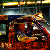A London taxi driver awaits passengers at 2am outside Stratford Station, adjacent to the Olympic Park, during the 2012 London Summer Olympics.