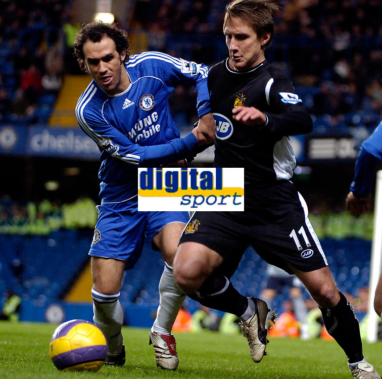 Photo: Ed Godden/Sportsbeat Images.<br />Chelsea v Wigan Athletic. The Barclays Premiership. 13/01/2007. Chelsea's Paulo Ferreira (L), holds off Andreas Johansson.
