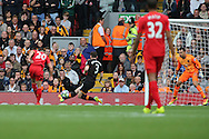 Adam Lallana of Liverpool FC shoots and scores his teams 1st goal. Premier League match, Liverpool v Hull City at the Anfield stadium in Liverpool, Merseyside on Saturday 24th September 2016.<br /> pic by Chris Stading, Andrew Orchard sports photography.