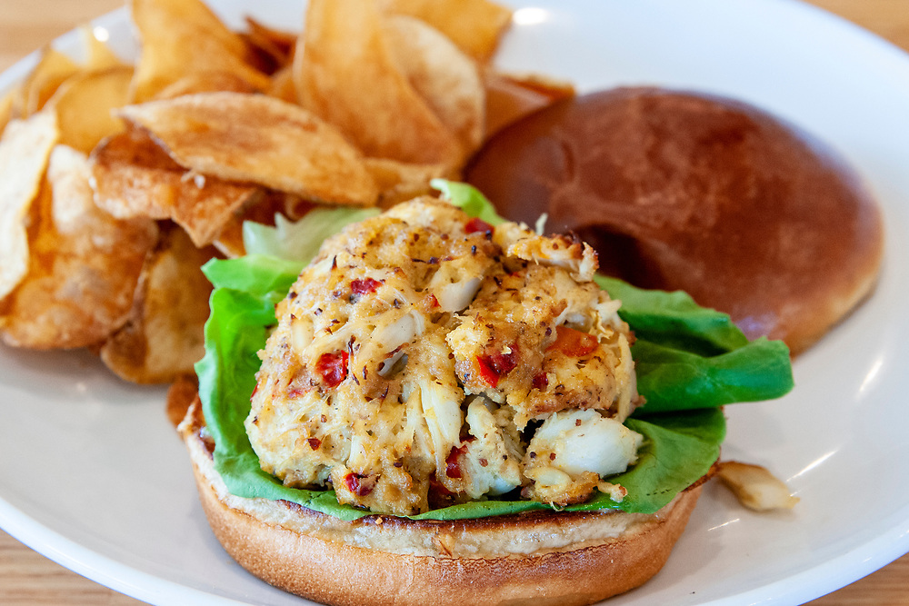 Crab cake sandwich for lunch at the Oceanic - a waterfront restaurant on an old fishing pier - in Wrightsville Beach, North Carolina on Tuesday, August 10, 2021. Copyright 2021 Jason Barnette