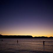 Fly fishermen fishing at sunset on the shores of Lake Toupo,,Toupo, New Zealand,, 9th January 2010 Photo Tim Clayton.