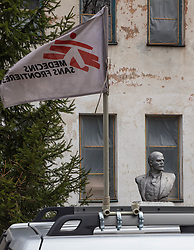The flag of Médecins Sans Frontères flutters in the wind outside the local medical clinic building in Zorinsk, near Lugansk, 16 April 2015. MSF is running a mobile clinic or adults and children affected by the recent conflict in the area in which buildings were damaged by artillery shelling and medical staff have left the town without ambulatory healthcare professionals.