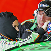 NASCAR Sprint Cup driver Danica Patrick is seen in the garage area speaking with Tony Gibson, during a NASCAR Daytona 500 practice session at Daytona International Speedway on Wednesday, February 20, 2013 in Daytona Beach, Florida.  (AP Photo/Alex Menendez)