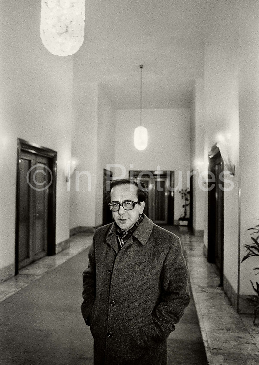 """Ismail Kadare (born January 28, 1936), a leading Albanian writer in a Tirana hotel weeks before his defection to France In 1990. Kadare claimed political asylum in France, issuing statements in favour of democratisation:  """"Dictatorship and authentic literature are incompatible... The writer is the natural enemy of dictatorship."""" Kadare never claimed to be Albanias's Solzhenitsyn, arguing that such a role wasn't readily available under Hoxha's uniquely paranoid and insular regime."""