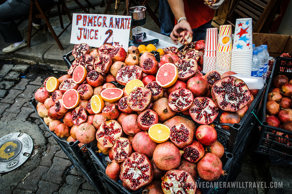 Pomegranites and fresh juice for sale in the Beyoglu district of Istanbul, Turkey.
