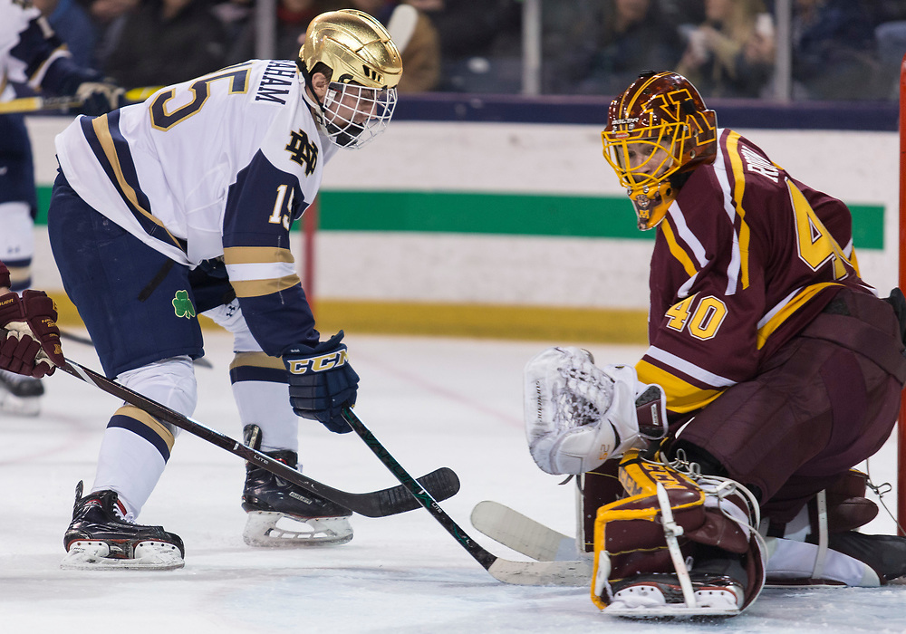 January 11, 2019:  Minnesota goaltender Mat Robson (40) makes the save on Notre Dame forward Michael Graham (15) during NCAA Hockey game action between the Minnesota Golden Gophers and the Notre Dame Fighting Irish at Compton Family Ice Arena in South Bend, Indiana.  Minnesota defeated Notre Dame 5-1.  John Mersits/CSM