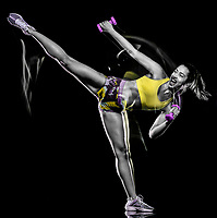 one mixed race woman exercising fitness exercises isolated on black background with lightpainting effect
