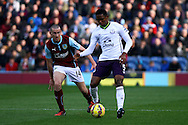 Everton's Samuel Eto'o holds off Burnley's David Jones. Barclays Premier league match, Burnley v Everton at Turf Moor in Burnley, Lancs on Sunday 26th October 2014.<br /> pic by Chris Stading, Andrew Orchard sports photography.