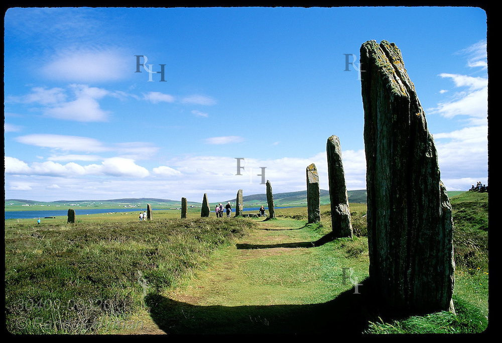 Visitors admire the stone megaliths of Ring of Brodgar (2800 BC) on a July day in Orkney Islands. Scotland