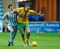 Photo: Daniel Hambury.<br />Coventry City v Norwich City. Coca Cola Championship.<br />26/11/2005.<br />Norwich's Darren Huckerby (R) battles with Coventry's Michael Doyle.