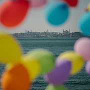 Balloons. Life along the shore of the Moda district, on the asian side of Istanbul.