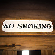 "SULLIVAN'S ISLAND, South Carolina - A ""no smoking"" sign above the entrance to a gunpowder storage building, or powder magazine. Fort Moultrie is part of the Fort Sumter National Monument at the entrance to Charleston Harbor in South Carolina. The fort has played a crucial role in defending the harbor from the time of the Revolutionary War through World War II. During that time it has undergone multiple upgrades, from the original palmetto log walls to the newer heavily fortified earthen bunkers."