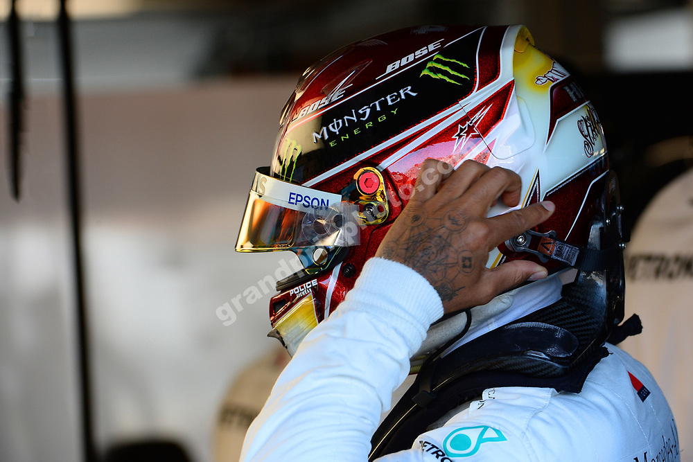Lewis Hamilton (Mercedes) puts his helmet and HANS on during practice for the 2019 Canadian Grand Prix in Montreal. Photo: Grand Prix Photo