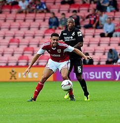 Bristol City's Derrick Williams holds up the ball from Bournemouth's Wes Thomas - Photo mandatory by-line: Dougie Allward/JMP - Tel: Mobile: 07966 386802 27/03/2013 - SPORT - FOOTBALL - Goldsands Stadium - Bournemouth -  Bournemouth V Bristol City - Pre Season friendly