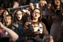 © Licensed to London News Pictures . 04/06/2017 . Manchester , UK . The audience sing along with Robbie Williams . The One Love Manchester benefit concert for victims of the Manchester Arena terrorist attack , at the Emirates Old Trafford Cricket Stadium . Ariana Grande, Justin Bieber, Coldplay, Katy Perry, Miley Cyrus, Pharrell Williams, Usher, Take That, Robbie Williams, Black Eyed Peas and Niall Horan are amongst the performers. Photo credit : Joel Goodman/LNP