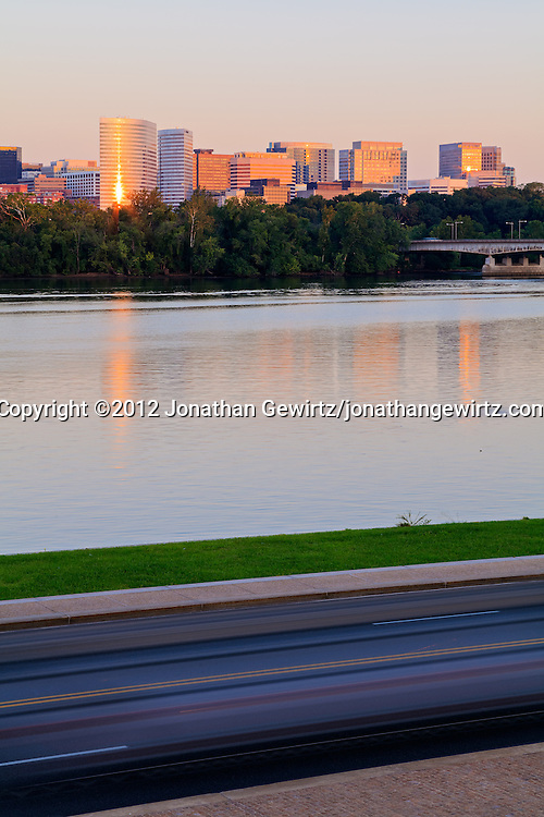 An early morning view of Rosslyn, Virginia, across Ohio Drive traffic and the Potomac River. WATERMARKS WILL NOT APPEAR ON PRINTS OR LICENSED IMAGES.