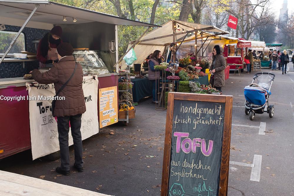 View of weekly Eko-Markt, or Eco-Market, at Kollwitzplatz in gentrified Prenzlauer Berg neighbourhood of Berlin , Germany