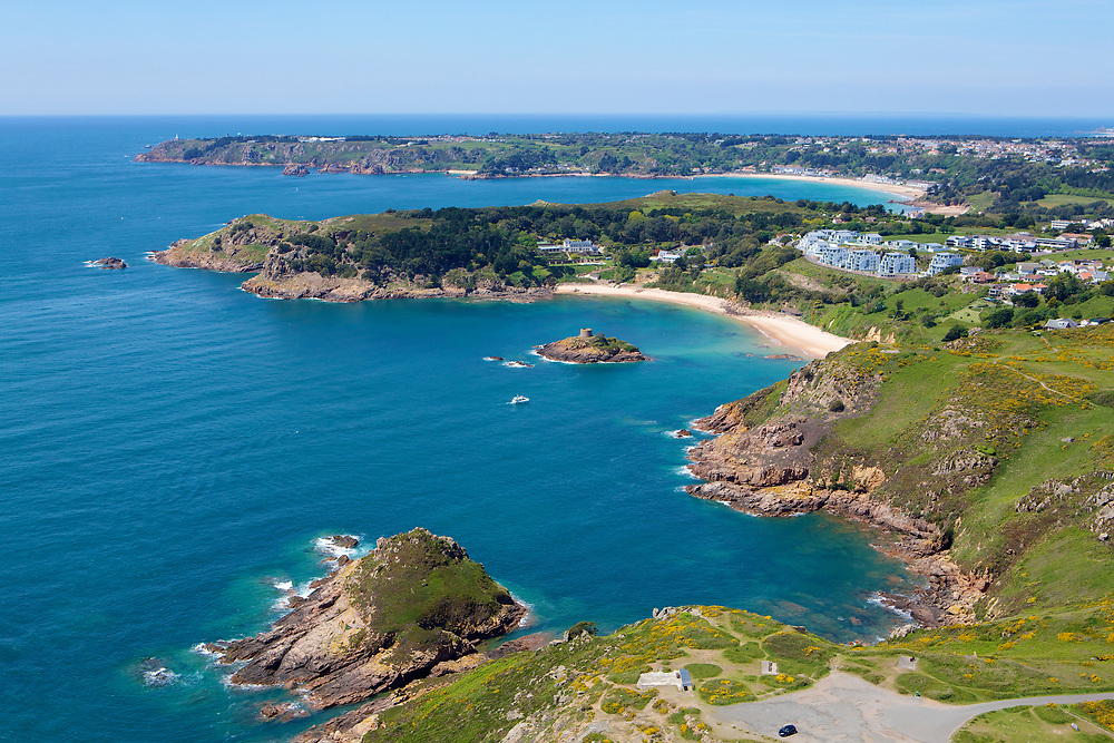 Aerial view of the coastline between Noirmont Point and Portelet beach with its calm, blue and turquoise water in Jersey, Channel Islands