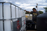 Water Warriors founder Zoel Zohnnie prepares for the next day's delivery of water at the team's warehouse in Gallup, New Mexico.