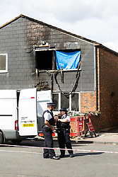Police guard the crime scene where seven-year-old Joel Urhie died in a suspected arson attack on his home in Deptford in the early hours of Tuesday 7th August. London, August 08 2018.