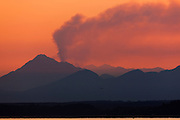 A tall column of smoke rises behind Mount Jupiter from the Big Hump fire in the Olympic National Forest, Washington. The fire, which started August 31, 2011, had grown to 1,150 acres at the time this image was taken September 10th.