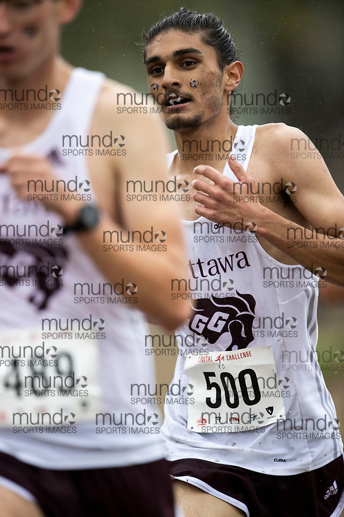 If you post on social media please tag @mundosportimages on Instagram or tag Mundo Sport Images on Facebook.<br /> <br /> (Ottawa, Canada---02 October 2021)  Rishab  Sahai (Ottawa Lions T.F.C.) competing in the University Men's / Open Men's race at the  2021 Capital Cross Country Challenge held at Mooney's Bay in Ottawa.  Photograph 2021 Copyright Sean Burges / Mundo Sport Images