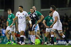 Ben Te'o of England attempts to walk away after a tackle from Robbie Henshaw of Ireland - Mandatory by-line: Ken Sutton/JMP - 18/03/2017 - RUGBY - Aviva Stadium - Dublin,  - Ireland v England - RBS 6 Nations