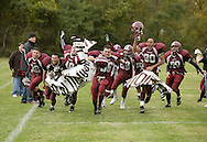 Cornwall-on-Hudson, New York - New York Military Academy football players run through a banner to celebrate their victory after defeating the Harvey School in a high school football game on Oct. 17, 2009.