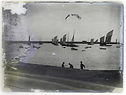 sea with boats scenic view on eroding glass plate