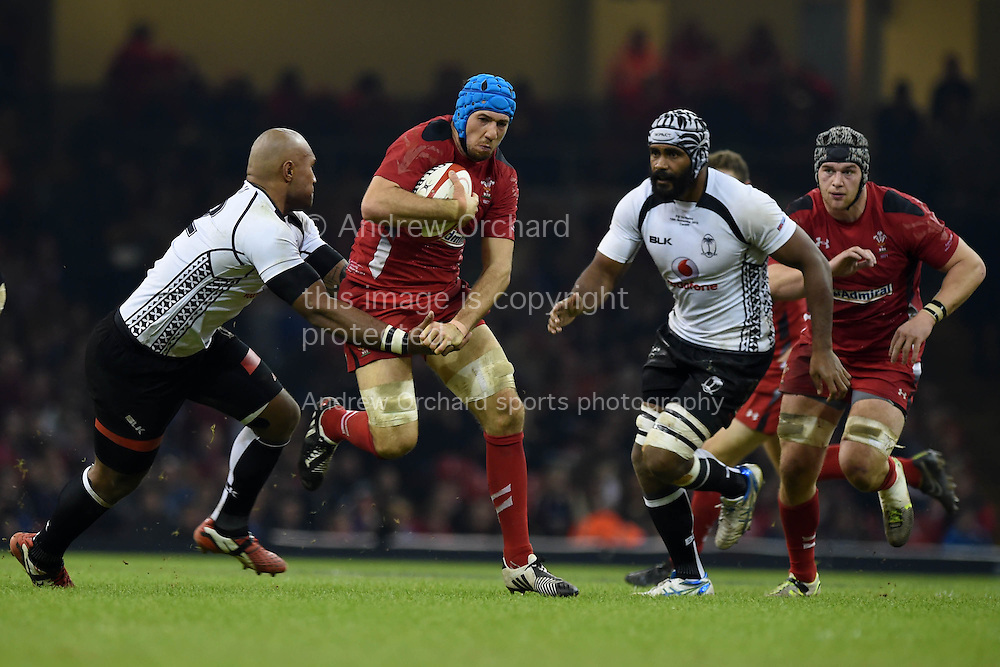 Justin Tipuric of Wales © makes a break.Dove Men series 2014, autumn international rugby, Wales v Fiji at the Millennium Stadium in Cardiff, South Wales on Saturday 15th November 2014.<br /> pic by Andrew Orchard, Andrew Orchard sports photography.
