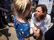 03 JULY 2019 - WEST DES MOINES, IOWA: US Senator KAMALA HARRIS, right, (D-CA)  talks to a girl at the West Des Moines Democrats' annual 4th of July Picnic. Senator Harris attended the picnic to support her bid to be the Democratic nominee for the US presidency in 2020. Iowa hosts the first presidential selection event of the 2020 election cycle. The Iowa Caucuses are scheduled for Feb. 3, 2020.       PHOTO BY JACK KURTZ