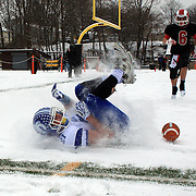 Nicholas Lombardo, Darien, just fails to make a catch in the end zone during the New Canaan Rams Vs Darien Blue Wave, CIAC Football Championship Class L Final at Boyle Stadium, Stamford. The New Canaan Rams won the match in snowy conditions 44-12. Stamford,  Connecticut, USA. 14th December 2013. Photo Tim Clayton
