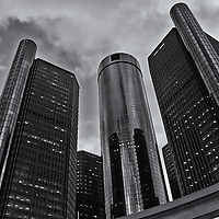 """""""The Renaissance Center"""" B&W<br /> <br /> The beautiful architecture and design of a group of buildings on the Detroit River Front, known as The Renaissance Center, The RenCen, or The GM Renaissance Center. <br /> <br /> This group of buildings is the world headquarters for General Motors!<br /> <br /> This image is done in a dramatic black and white for those that love monochrome!!<br /> <br /> Cities and Skyscrapers by Rachel Cohen"""