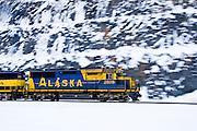 Alaska Railroad engine run along side the Seward Highway at Turnagain Arm in winter