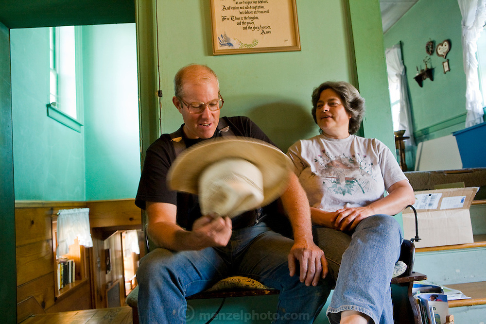 Joel Salatin, a farmer and author, with his wife at their farm in Virginia's Shenandoah Valley. (Joel Salatin is featured in the book What I Eat: Around the World in 80 Diets.)  Much of his daily fare is from his own farm, including applesauce and apple cider canned by his wife, Teresa, who fills the basement larder with the bounty of their farm each year.