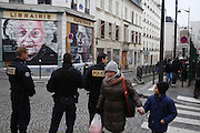 Police security near Jewish School after armed gunmen attacked the offices of Charlie Hebdo, killing twelve people, including the editor and celebrated cartoonists; four more are in critical condition. It is the dealiest terror attack in France for over fifty years. Charlie Hebdo is a satirical publication well known for its political cartoons.