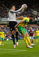 Football - 2021 / 2022 Premier League - Burnley vs. Norwich City - Turf Moor - Saturday 2nd October 2021<br /> <br /> Burnley keeper Nick Pope leaps to take a cross over the challenge of Grant Hanley of Norwich City, at Turf Moor.<br /> <br /> <br /> COLORSPORT/ALAN MARTIN
