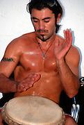 A male drummer at drummers beach, Tel Aviv, Israel