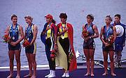 Sydney, AUSTRALIA, W2- Medallist on the awards doc left Silver Medallist, AUS W2- TAYLOR  Rachael and  SLATTER, Kate Elizabeth, centre  ROM W2- Gold medallist  DAMIAN  Georgeta and IGNAT Doina,  right Bronze medallist USA W2- RYAN Melissa, KRAFT, Karen at the 2000 Olympic Regatta, Penrith Lakes. [Photo Peter Spurrier/Intersport Images] 2000 Olympic Regatta Sydney International Regatta Centre (SIRC) 2000 Olympic Rowing Regatta00085138.tif