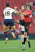 Jaque Fourie and Mark Gerrard competes for the ball in the air in the Super 14 match between the Lions and the Brumbies that took place on Saturday 21 March 2009 at Coca-Cola Park in Johannesburg South Africa. The Lions won this Super 14 match against the Brumbies 25 - 17.  <br /> Photographer : Anton de Villiers / SASPA