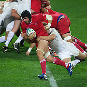 Dimitri Basilaia, Georgia, breaks the tackle of England captain Lewis Moody to score a try for the minnows during the England V Georgia Pool B match during the IRB Rugby World Cup tournament. Otago Stadium, Dunedin New Zealand, 18th September 2011. Photo Tim Clayton...