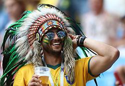 A Brazil fan in the stands wears a head dress