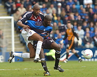 SPORTSBEAT 01494 783165<br /> PICTURE ADY KERRY .<br /> GILLINGHAM VS IPSWICH TOWN<br /> GILLINGHAM'S  MAMADY SIDIBE CHALLENGES WITH IPSWICH'SDRISSA DIALLO 17TH APRIL 2004.