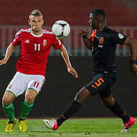 Hungary's Vladimir Koman (L) and Netherlands' Jetro Willems (R) fight for the ball during a World Cup 2014 qualifying soccer match Hungary playing against Netherlands in Budapest, Hungary on September 11, 2012. ATTILA VOLGYI
