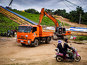 09 AUGUST 2018 - KAENG KRACHAN, PHETCHABURI, THAILAND: The Royal Thai Army and contractor construction crews build emergency spillways for the Kaeng Krachan Dam. The Phetchaburi River flows from Kaeng Krachan Dam to the Gulf of Siam through several towns including Ban Lat, Phetchaburi (the capital of Phetchaburi province) and Ban Laem. Government officials have warned residents of those towns that their towns will flood because the reservoir behind the dam is approaching capacity. Ban Lat and Phetchaburi could be flooded for several weeks. Residents of Ban Laem have been warned that their community could be inundated for over a month. Dams in Kanchanaburi province, west of Phetchaburi, are also approaching capacity and flooding is also expected in that area.   PHOTO BY JACK KURTZ
