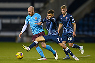 Danny Armstrong (#7) of Raith Rovers FC tackles Liam Boyce (#10) of Heart of Midlothian FC during the SPFL Championship match between Raith Rovers and Heart of Midlothian at Stark's Park, Kirkcaldy, Scotland on 30 April 2021.