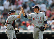 Joe Nathan, right, of Minnesota is congratulated by catcher Mike Redmond..The Minnesota Twins defeated the Cleveland Indians 4-2 on Sunday, July 27, 2008 at Progressive Field in Cleveland.